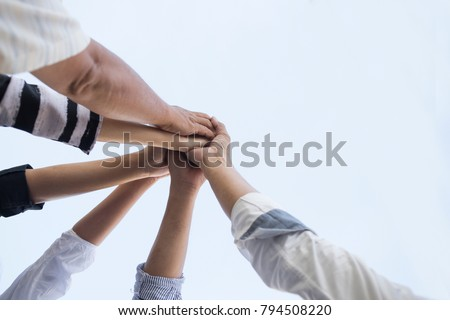 Teamwork group of young people putting their hands together for showing unity . #794508220