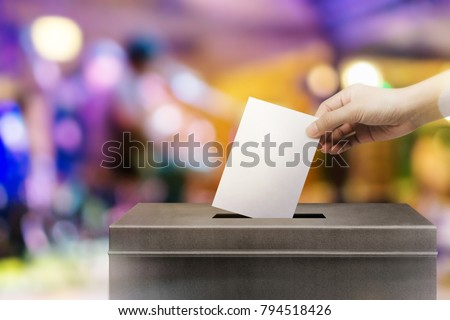Colorful fo election vote, hand holding ballot paper for election vote concept at colorful background. #794518426