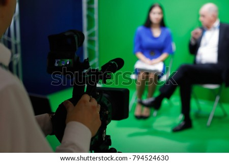 Video recording of an interview in tv green screen studio. Selective focus.