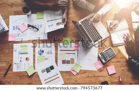 Business People Meeting using laptop computer,calculator,notebook,stock market chart paper for analysis Plans to improve quality next month. Conference Discussion Corporate Concept Royalty-Free Stock Photo #794573677