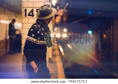 Man waiting for the subway in New York #794575717