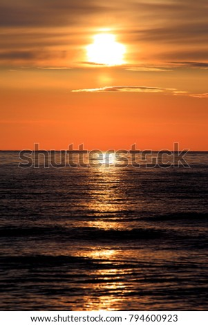 Colorful sunset over the Baltic Sea shore and beach in Rowy, Poland #794600923