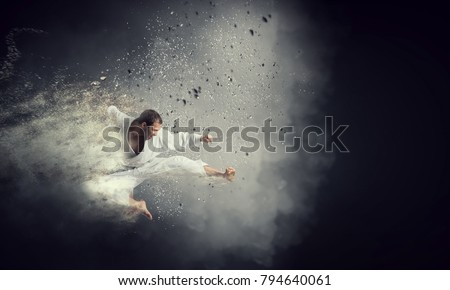 Fighter practising his art Royalty-Free Stock Photo #794640061