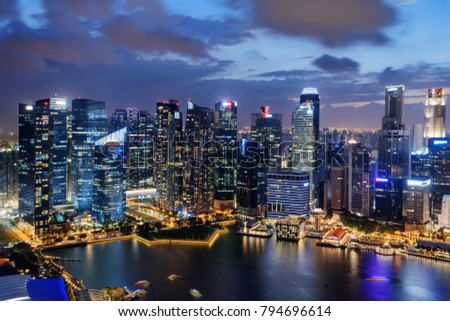 Amazing night view of skyscrapers at downtown of Singapore. Colorful city lights reflected in water of Marina Bay. Beautiful cityscape. Singapore is a popular tourist destination of Asia. #794696614