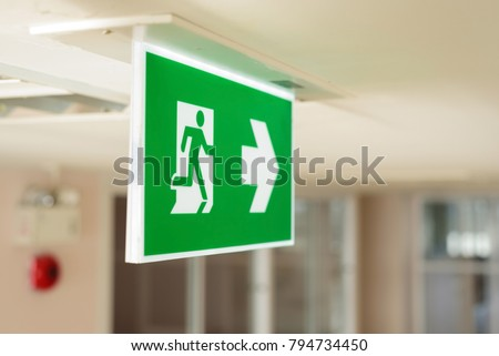 Selective fire exit sign on ceiling.Fire fighting equipment concept.
