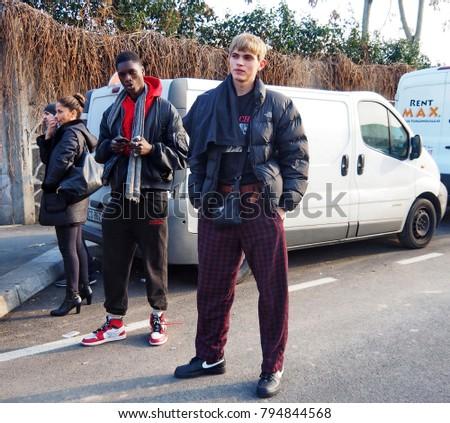 MILAN - JANUARY 14: Young man posing for photographers before DAKS fashion show, during Milan Fashion Week Man fall/winter 2018/19 on January 14, 2018 in Milan. #794844568