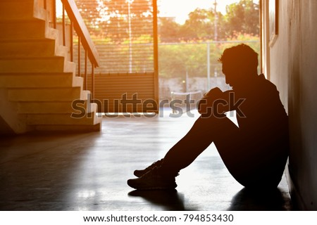 Silhouette of Sad Depressed Insomnia Man.Sitting Against Sunset. The Protection and Treatment of Major Depressive Disorder Problem Concept. Royalty-Free Stock Photo #794853430