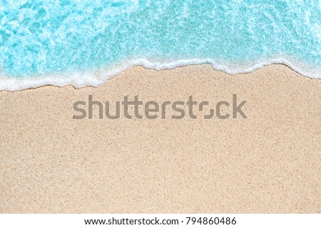 Background image of Soft wave of blue ocean on sandy beach.  Ocean wave close up with copy space for text Royalty-Free Stock Photo #794860486