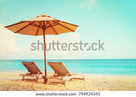 Two beach chairs on tropical vacation #794924341