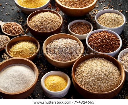 Various groats, cereals. Different types of groats in bowls  on a  black background. Healthy nutrition food #794924665