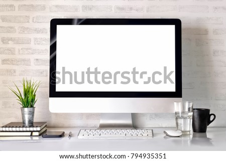 Modern clean workspace mockup with blank screen desktop computer and office supplies.