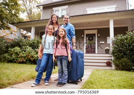 Portrait Of Family With Luggage Leaving House For Vacation #795016369