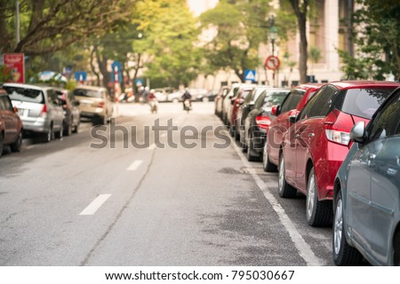 Cars parked on the urban street side #795030667