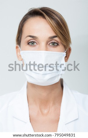 portrait of a doctor with a mask #795049831
