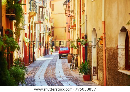 Typical colorful Italian houses on a street of Bosa, Sardinia, Italy #795050839