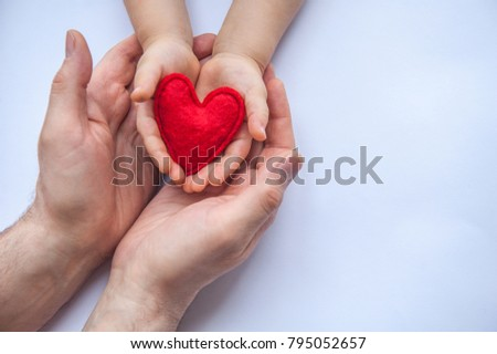 Red heart in hands - mother or dad and child. Valentine's day. Mother's Day. Love and health care.  Family insurance.  #795052657