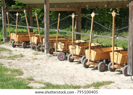 many wooden handcarts Royalty-Free Stock Photo #795100405