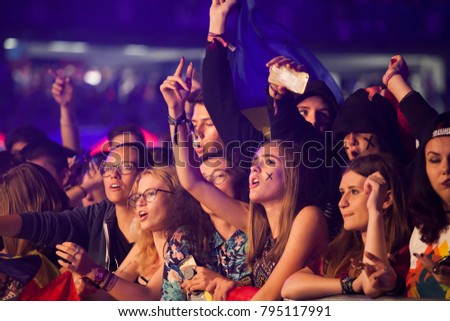 Cluj-Napoca, Romania - August 6, 2017: Crowd of young fans of Martin Garrix, popular dutch DJ, waiting for the show at Untold Festival, the Best Major Music Festival of Europe #795117991