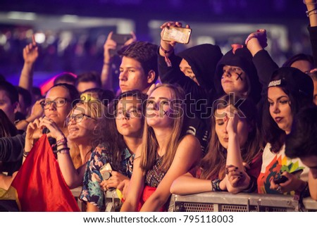 Cluj-Napoca, Romania - August 6, 2017: Crowd of young fans of Martin Garrix, popular dutch DJ, waiting for the show at Untold Festival, the Best Major Music Festival of Europe #795118003