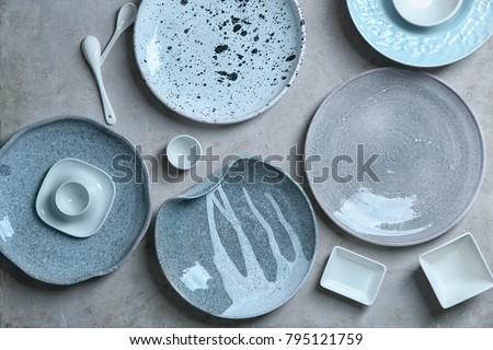 Ceramic tableware on grey background Royalty-Free Stock Photo #795121759