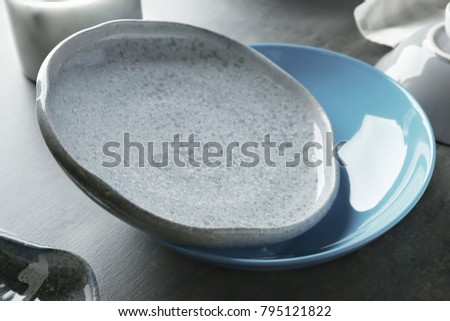 Ceramic plates on table, closeup #795121822