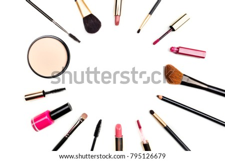 Makeup brushes, pencil, lipstick, and other objects, forming a frame on a white background, with copy space. A template for a makeup artist's business card or flyer design