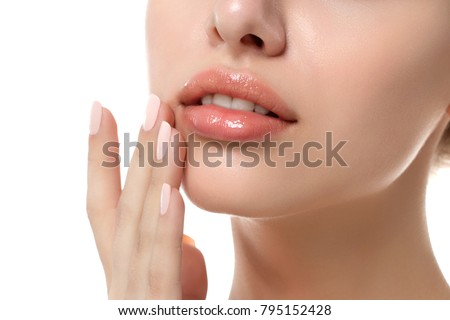 Close up view of young beautiful caucasian woman face isolated over white background. Lips contouring, SPA therapy, skincare, cosmetology and plastic surgery concept Royalty-Free Stock Photo #795152428