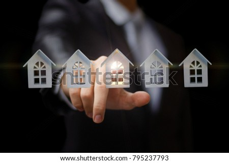 Businessman clicks on the house. The choice of the property. #795237793