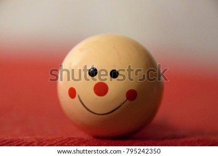 Smiley face with red nose and black eyes on the red background #795242350