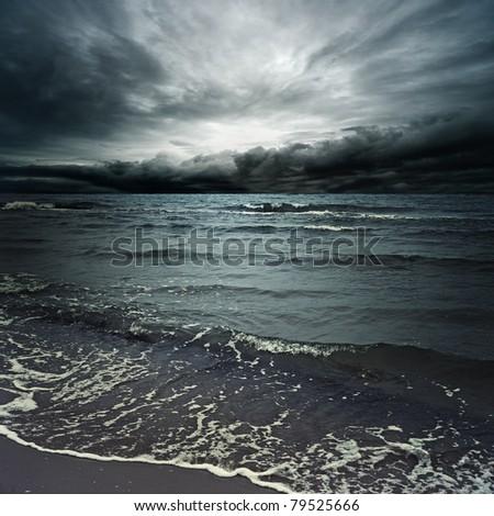 Stormy clouds over dark ocean #79525666