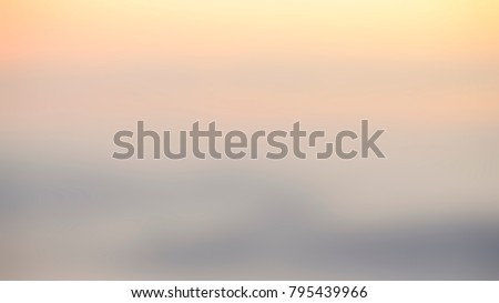 Blurred Sunrise Background, Early Morning Light, The Natural Lighting Phenomena. Royalty-Free Stock Photo #795439966