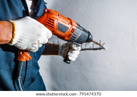 man with electric drill #795474370