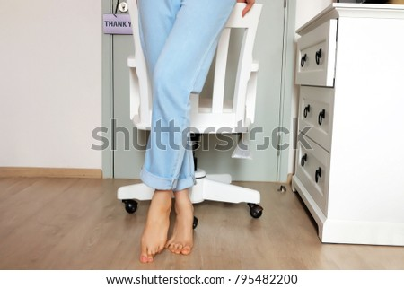 Close Up Stand on Chair Studio. Beautiful Woman Standing with a White Chair in the White Room Studio Background Great for Any Use. #795482200