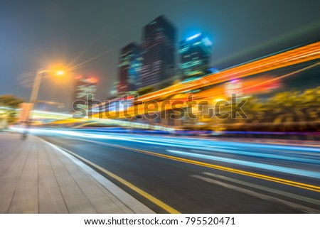 Vehicle light trails in city at night #795520471