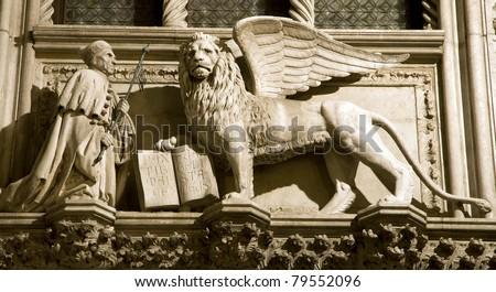 Venice - lion of St. Mark the Evengelist from portal of Doge palace - Porta Della Carta - Francesco Foscari #79552096