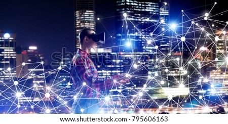 Young man with virtual reality headset or 3d glasses among connection lines #795606163