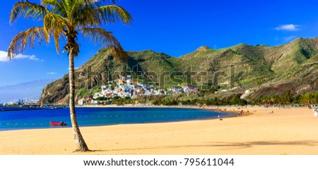 Best Beaches of Tenerife - gold sandy Las Teresitas with scenic San Andres village. Canary islands of Spain Royalty-Free Stock Photo #795611044