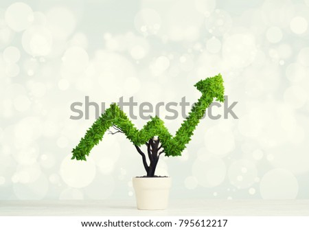 Small plant in pot shaped like growing graph #795612217