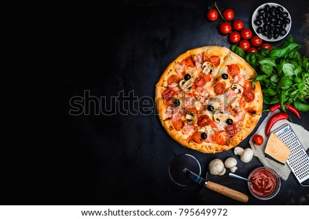 Traditional Italian pizza, vegetables, ingredients on a dark metallic background. Pizza is cooking in the oven. Pizza menu. View from above. Space for text. #795649972