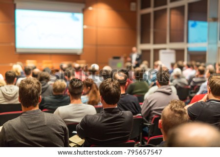 Speaker giving a talk in conference hall at business event. Audience at the conference hall. Business and Entrepreneurship concept. #795657547