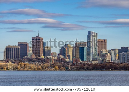 The Boston skyline and Charles River, seen from Cambridge with clouds, Massachusetts.