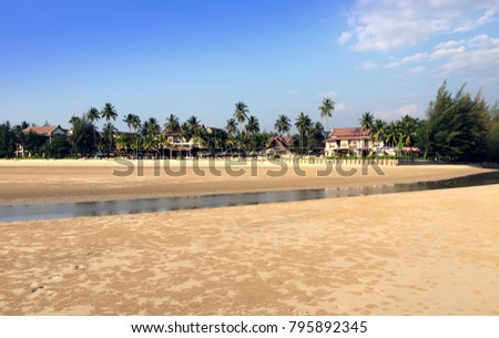 Thailand. The sandy beach during a sea outflow. #795892345