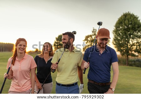 Group of friends walking on the golf course #795929302