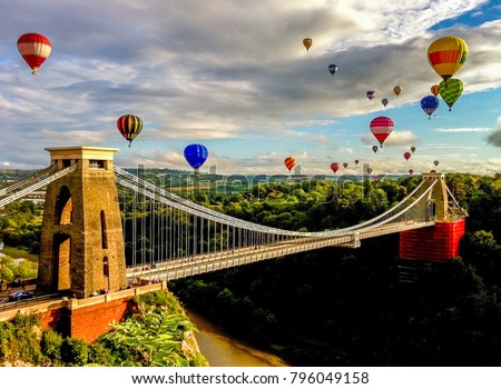 The international balloon fiesta is an annual event in Bristol. This photo captures the afternoon flight as the balloons come over the Clifton Suspension Bridge. Photo taken in 2012. #796049158