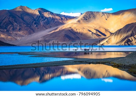 Leh, Ladakh,  India-June 8 2017: Landscape with reflections of the mountains on the  lake named Pagong Tso, situated on the border with India and China. #796094905