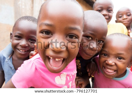 Lugazi, Uganda. 9 June 2017. A group of little smiling and curious children. #796127701