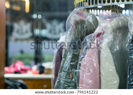 Laundry in the dry cleaner. #796141222