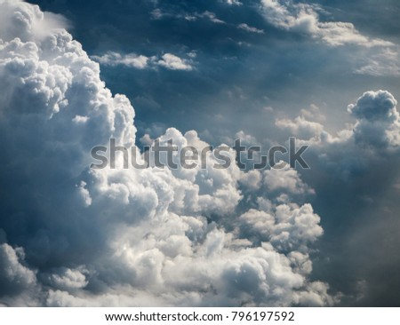 The sky bakground in Morning time,reflection of sunlight is shining to smoky waving cloud,cumulus cloud plenty of backgorund,before climate change,beautiful top view,beauty by nature. Royalty-Free Stock Photo #796197592