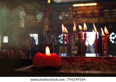 Burning red chinese candle in temple #796199584
