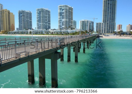 SUNNY ISLES BEACH, USA - DEC 9, 2017: Spectacular view to coastline and condominiums from Newport Fishing Pier, Florida #796213366